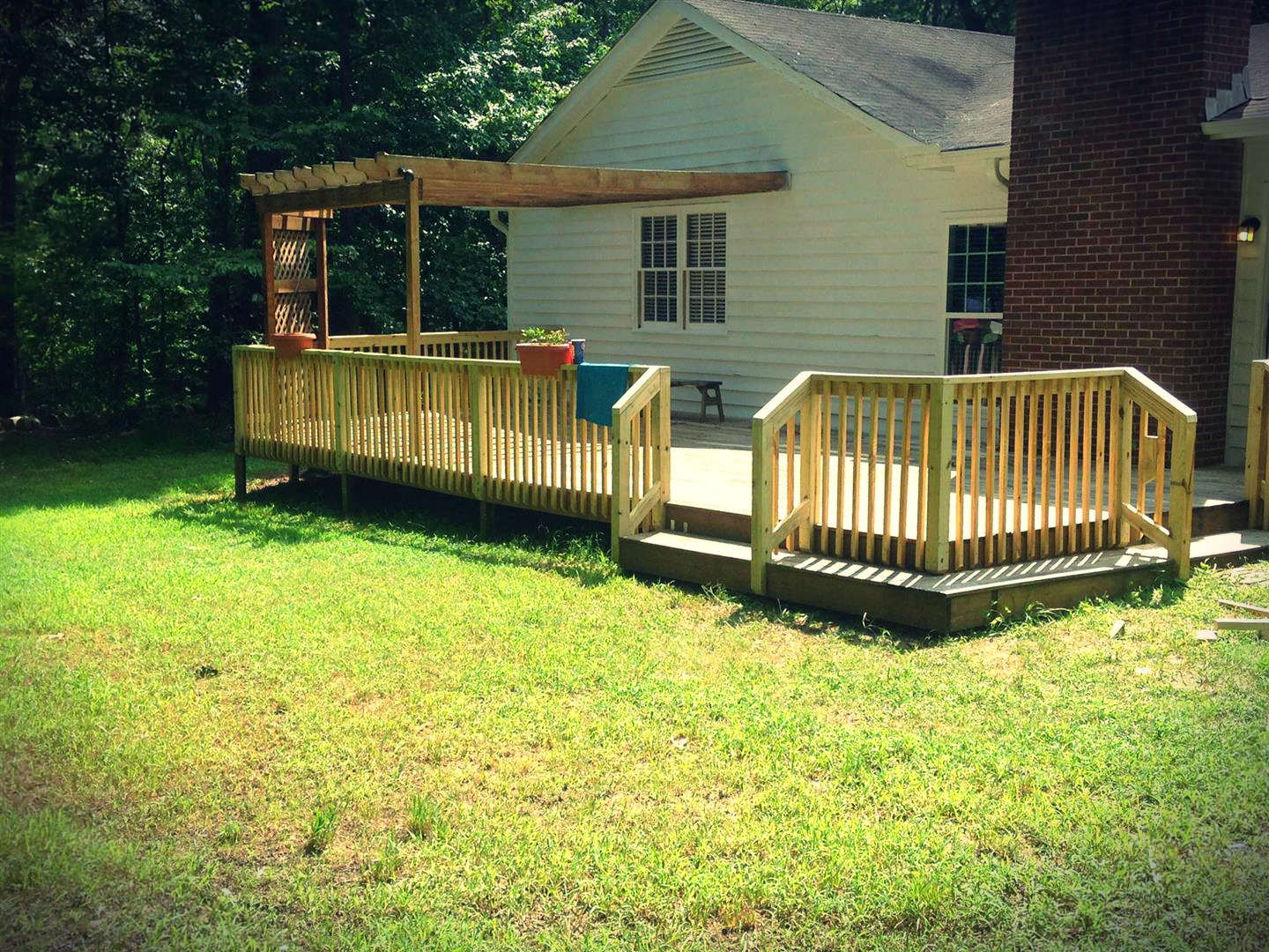 Deck and pergola constructed off the rear of a home.