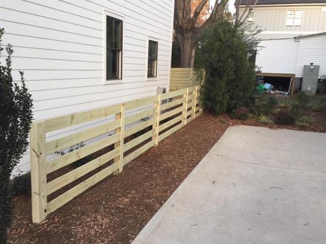 Modern wood fence built by FortSmith Landscaping.