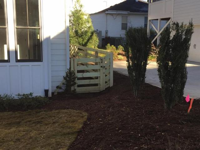 New fence installed on the right side of a home.