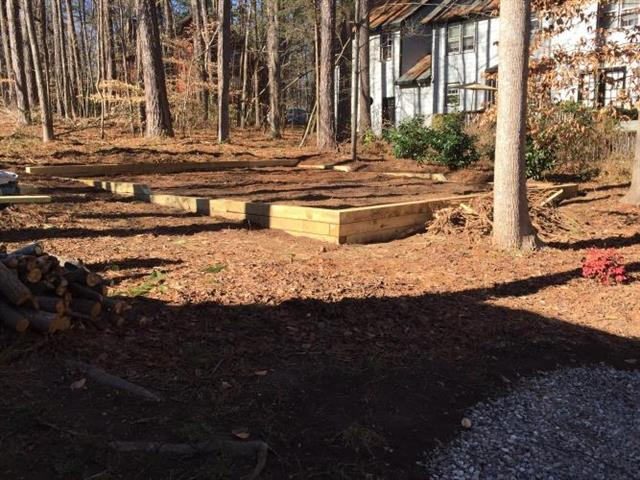 Leveled area and timber retaining wall for swingset